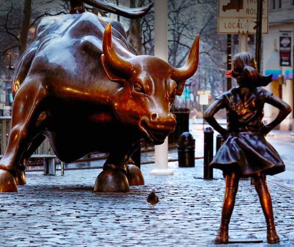 On the eve of International Women's Day, an asset management company (State Street Global Advisors), placed a statue of a little girl in front of Manhattan's iconic charging bull sculpture to highlight a lack of gender diversity and equality in the workplace. The statue, which is by artist Kristen Visbal is called The Fearless Girl and may remain staring defiantly at the bull for up to a month, if not longer, Reuters reported. Photo: REUTERS/Brendan McDermid